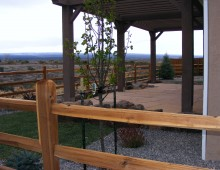 A full landscape install with a raised flagstone patio and pergola