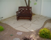A Backyard Landscape With a Trex Deck and Small Flagstone Patio