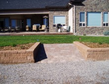 Versa-Lok Retaining Wall With Ramp and Small Brick Path